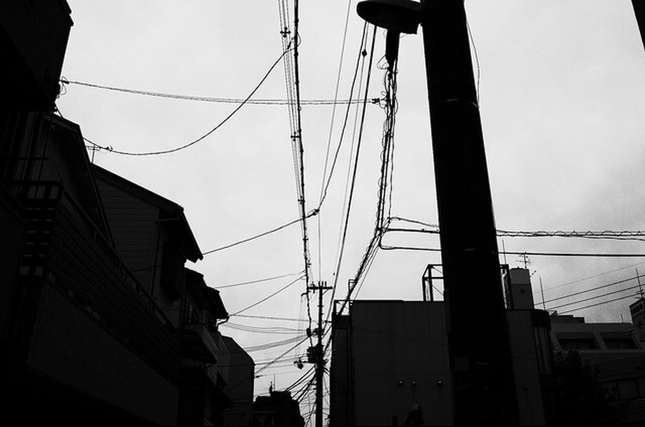 cable, power line, low angle view, connection, power supply, electricity, sky, electricity pylon, fuel and power generation, built structure, technology, day, no people, outdoors, silhouette, architecture, telephone line, building exterior, complexity