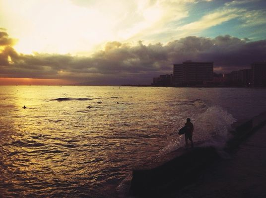sunset at Waikiki Pier by Devin Jenkins