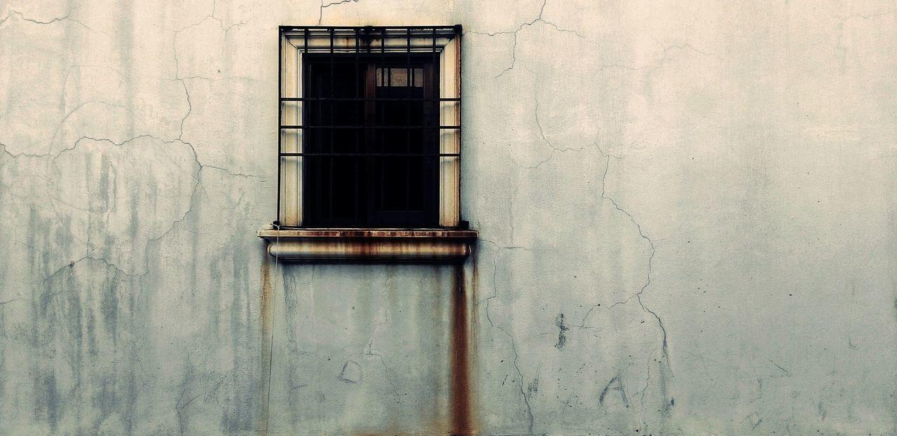 Rusty Window On Wall