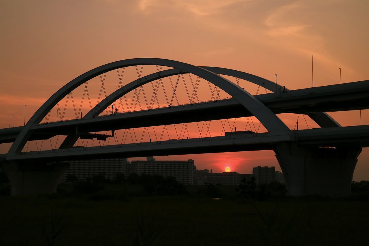 bridge - man made structure, connection, sunset, orange color, transportation, architecture, built structure, sky, outdoors, no people, nature, city, day