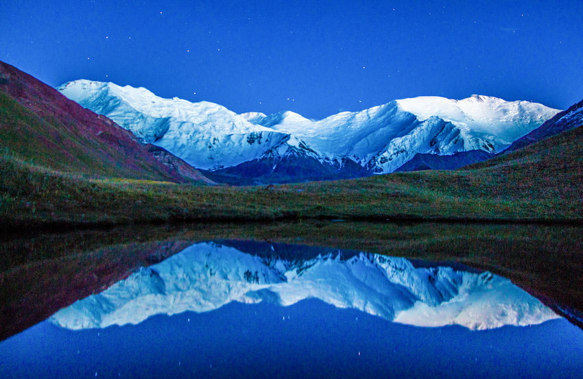 Kyrgyzstan Pamir Mountains Blue Day Idyllic Lake Landscape Mountain Mountain Range Nature Night No People Outdoors Pamir Reflection Scenics Sky Snow Snowcapped Mountain Stars Tranquil Scene Travel Destinations Water Waterfront Winter