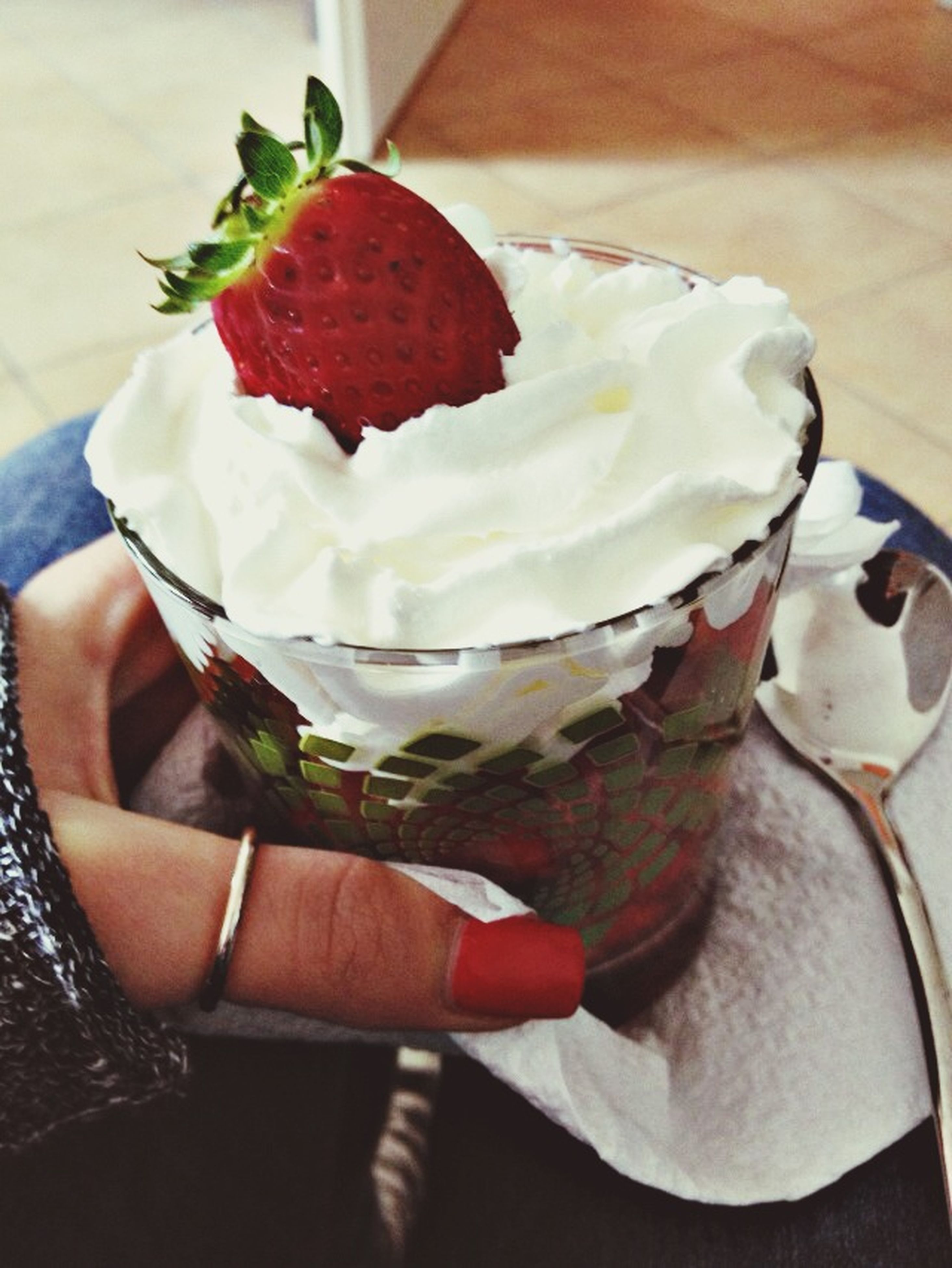 food and drink, sweet food, holding, freshness, person, dessert, indoors, indulgence, frozen food, ice cream, food, unhealthy eating, red, lifestyles, close-up, strawberry, temptation
