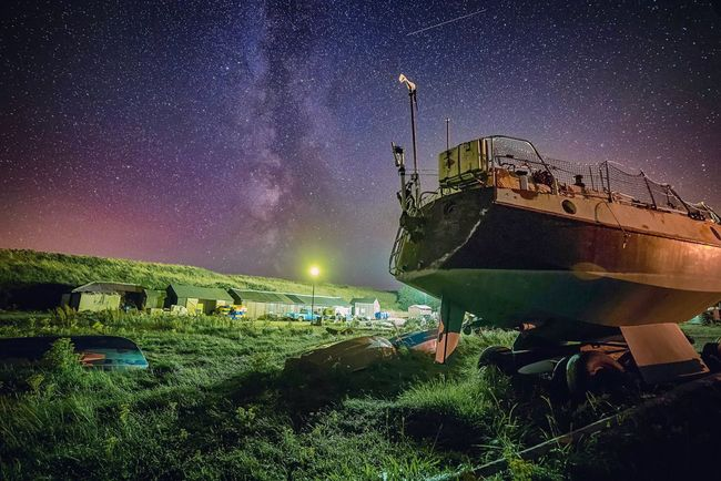 Shipyard Stardust | Lights out, Words gone Tranquil Scene Scenics Nautical Vessel Boat Illuminated Lens Flare Transportation Night Mode Of Transport Sky Tranquility Green Color Beauty In Nature Nature Journey Star Field Milkyway Nightphotography Northumberland Starry Sky Long Exposure My Favorite Place Colourfulsky EyeEm Masterclass Atmospheric Mood