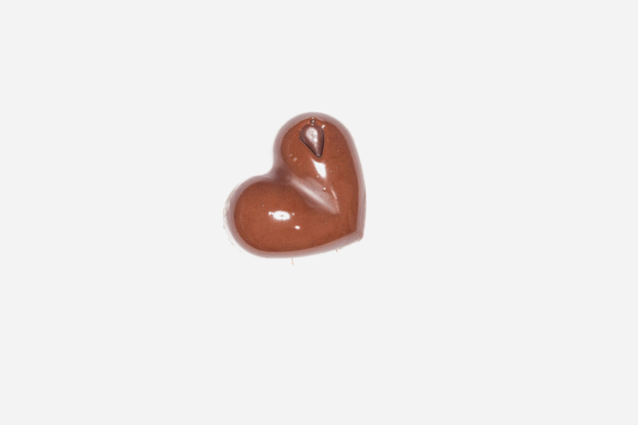 Close Up Of A Black Chocolate Piece Having A Heart Shape On A White Background Alone Backgrounds Birthday Black Chocolate Brown Calorie Chocolate Sauce Christmas Close-up Delicious Dessert Diet Food Gastronomy Gourmet Heart Homemade I Love Chocolate! Love No People Single Spring Studio Shot Valentine's Day  White Background