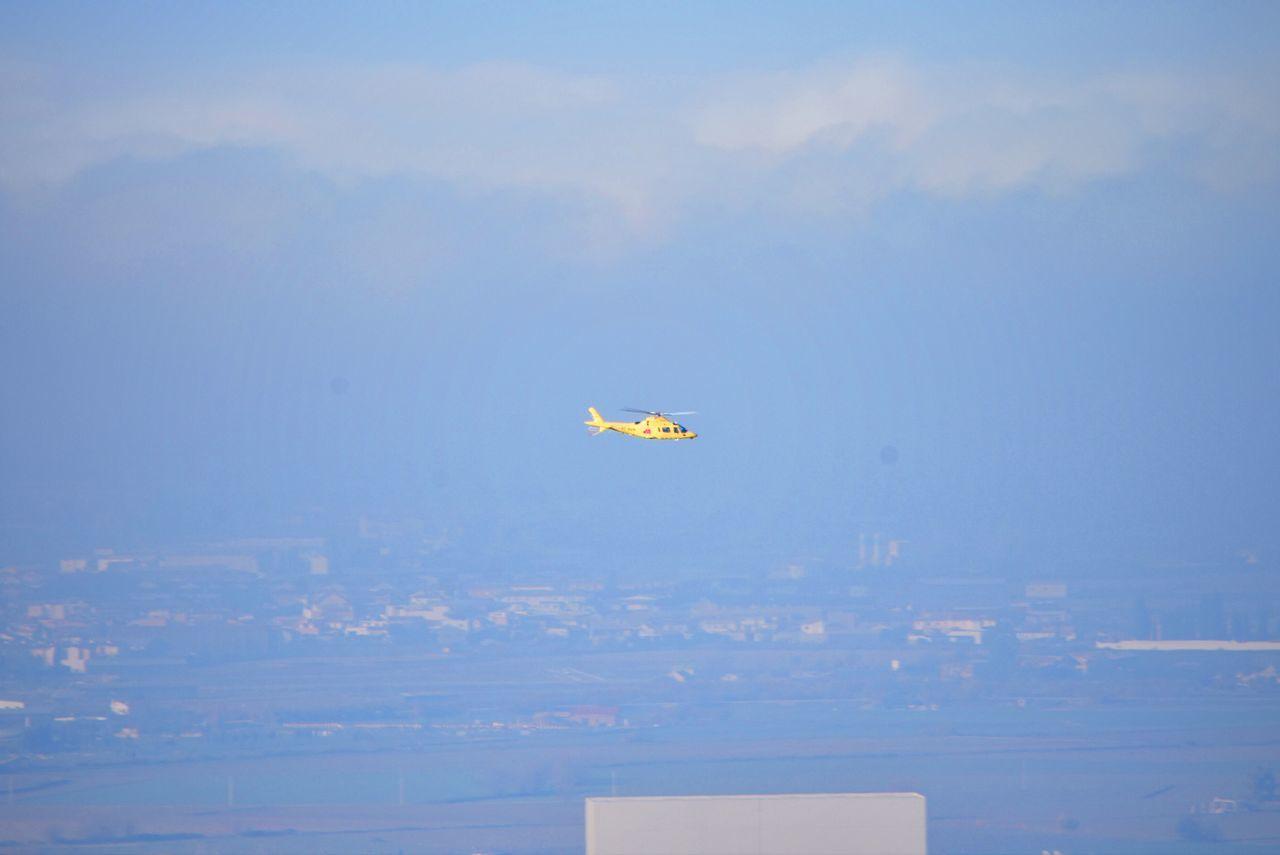 Helicopter Flying Over Landscape