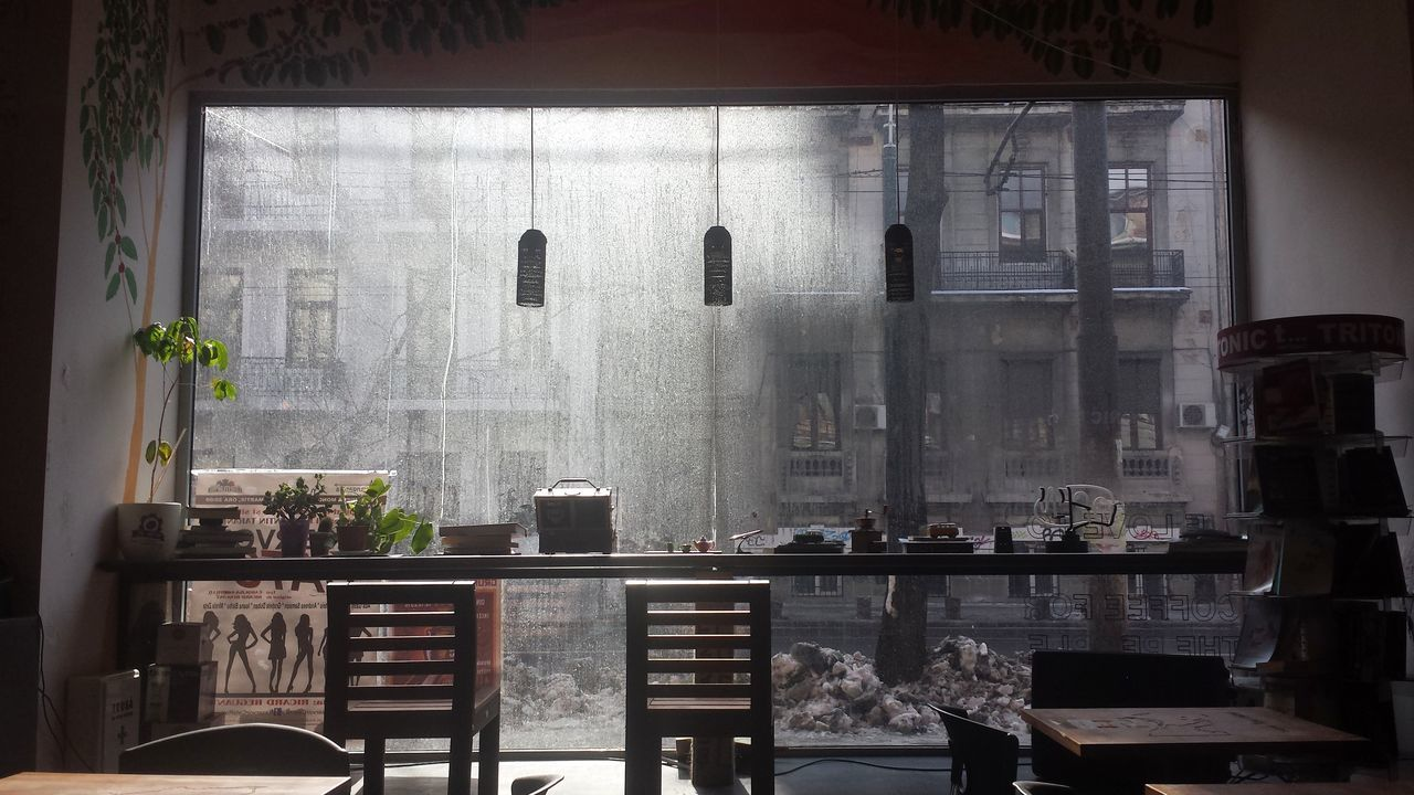 Indoors  Table Window Chair No People Day Architecture Coffee Shop Coffee Coffee Time Bucharest Photography Love Going Out View Perfection Nofilter Original Lights Urban City The Coffee Factory February Cityscape