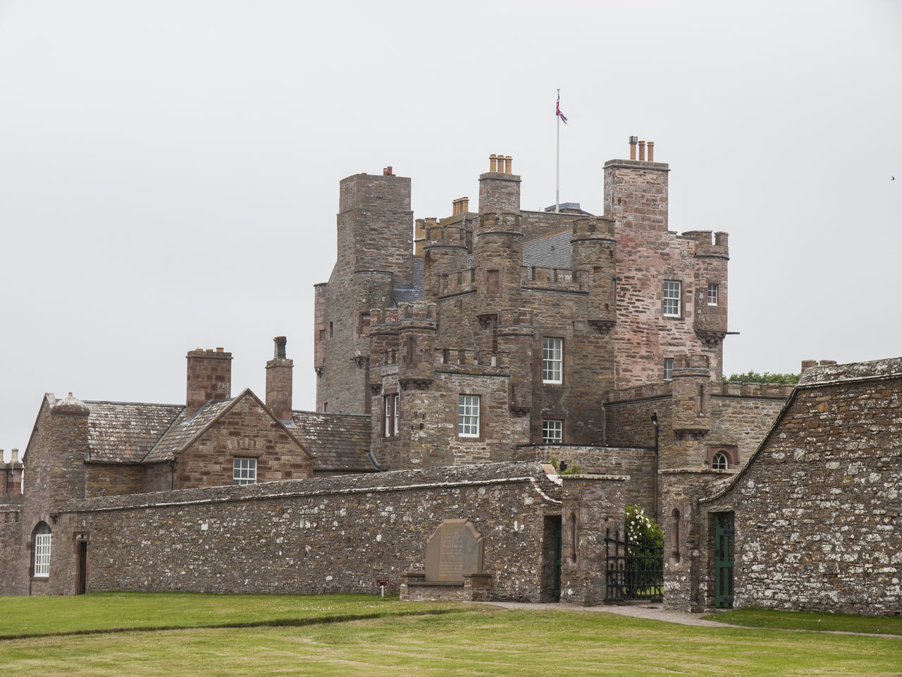 The Queen Mothers Castle of Mey Scotland.The castle was in a semi-derelict state when, in 1952, it and its policies (attached lands) were purchased by Queen Elizabeth The Queen Mother, the widow of King George VI who had died earlier in the year. The Queen Mother set about restoring the castle for use as a holiday home, removing some of the 19th-century additions, and reinstating the Castle's original name. She regularly visited it in August and October from 1955 until her death in March 2002, the last visit being in October 2001. Animal Themes Architecture Bird Building Exterior Built Structure Castle Castle Of Mey Clear Sky Day Field Flying Grass Green Color Medieval Outdoors Rural Scene Scotland. Tall - High The Queen Mother Tourism Tranquility Travel Destinations Vivid International