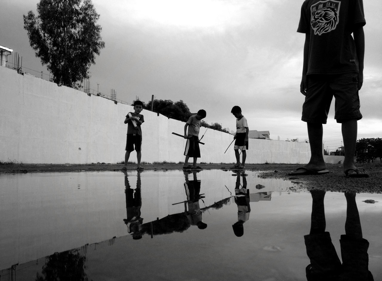Kids playing after the rain. Casual Clothing Cloud - Sky Day EyeEm EyeEm Pampanga Eyeem Philippines Leisure Activity Lifestyles Medium Group Of People Men Nature Outdoors Reflection Sky Standing Water Streetphotography Tranquility Water Weather Eyeemphoto