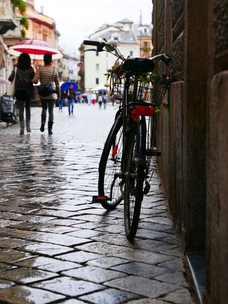 Street Scene People Walking In The Rain Umbrellas Bike Italy