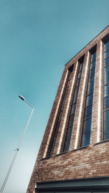 Architecture Low Angle View Built Structure Modern Building Exterior No People Outdoors Day Sky Modern Building Modern Architecture City Morning Walk Walking Around Spacer Po Szczecinie Szczecin Street Lamp Clear Sky Blue Red