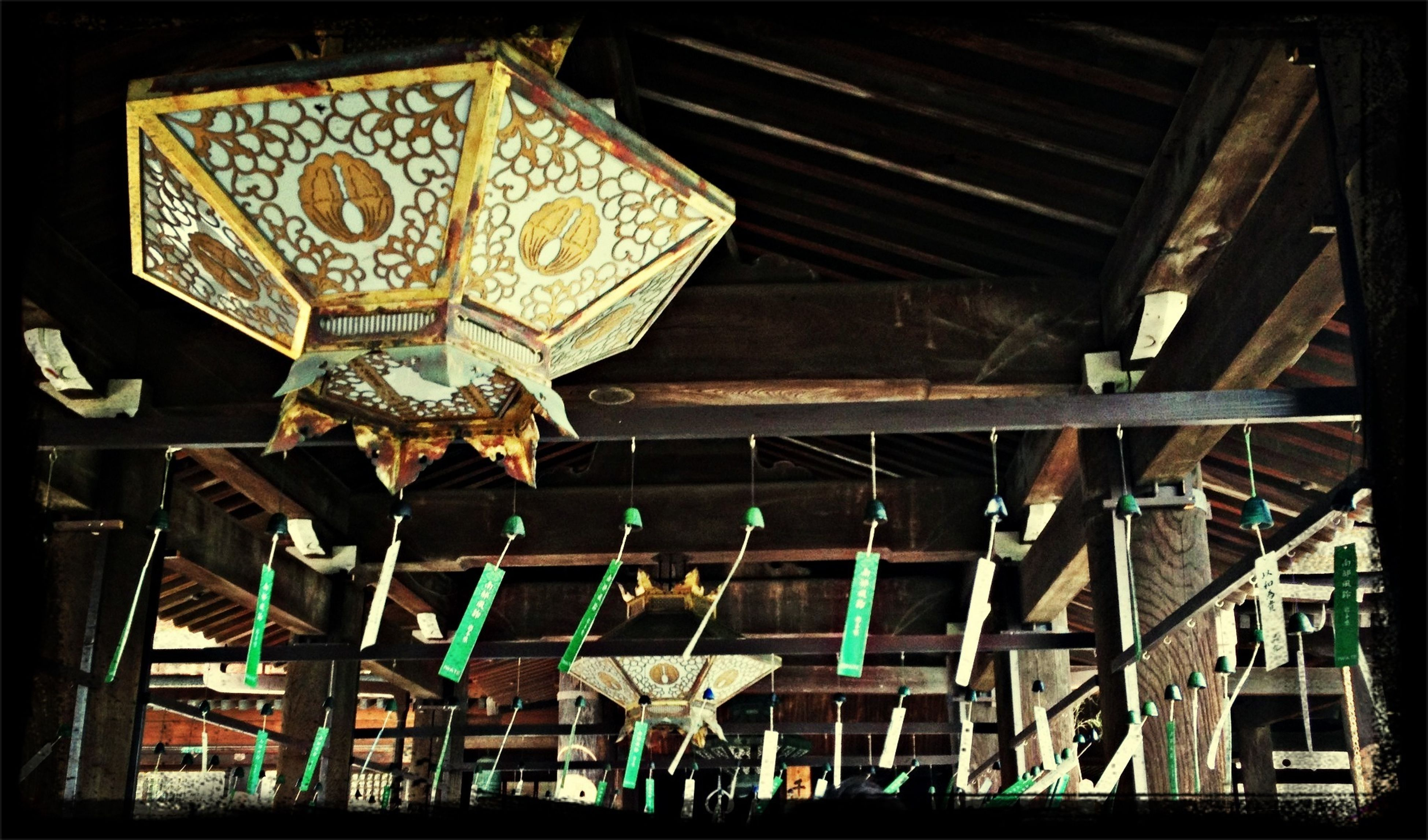low angle view, indoors, built structure, architecture, ceiling, wood - material, hanging, illuminated, place of worship, religion, art and craft, ornate, spirituality, lighting equipment, art, arts culture and entertainment, creativity, design, pattern, temple - building
