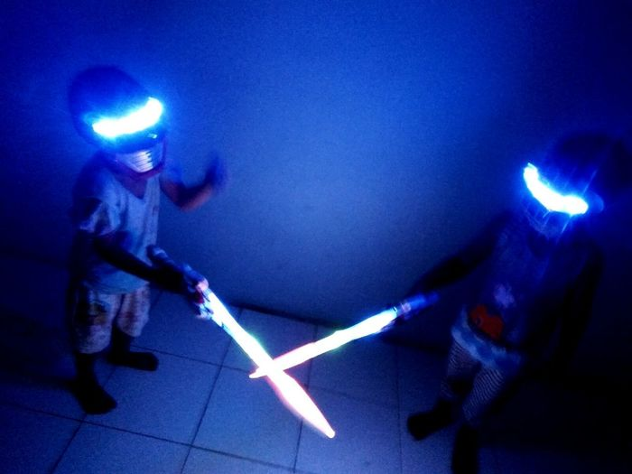 Blurred Motion People Night Illuminated Indoors  Sword Fight Playing Rangers Sister And Brother Sibling Boy And Girl Child Childhood Children