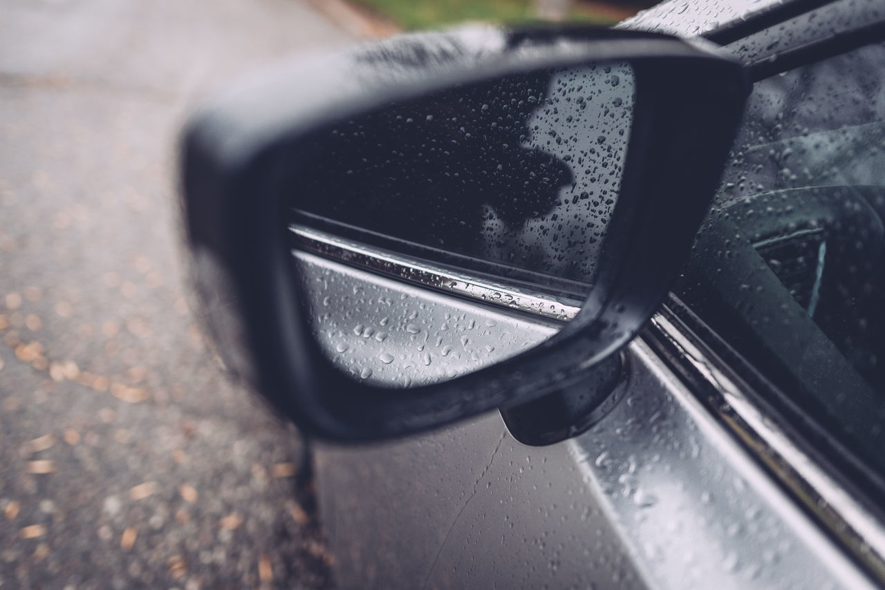 Close-Up Of Wet Car Side-View Mirror
