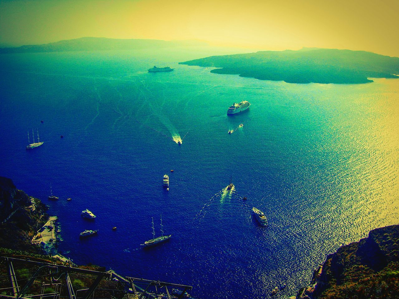 nautical vessel, sea, transportation, water, high angle view, beauty in nature, mode of transport, scenics, nature, boat, tranquil scene, outdoors, tranquility, no people, ship, day, sunset, sky, sailing, mountain, yacht