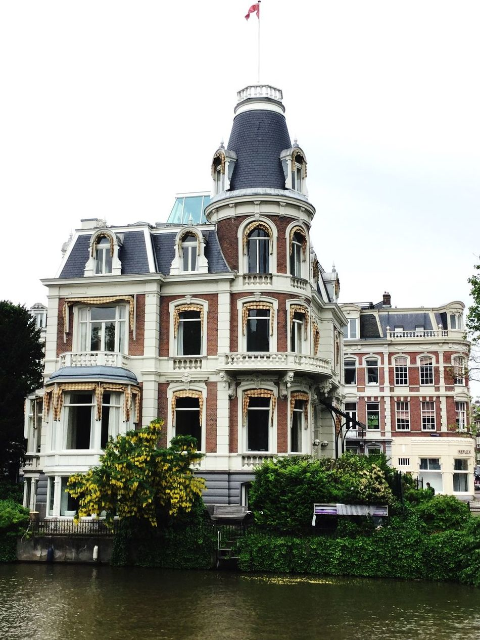Architecture Iamamsterdam Building Exterior City Travel Destinations Tree Day Cultures Water Outdoors Built Structure Amsterdam Spring FreeTour City Of Bicycles