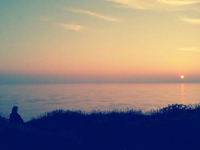 Having deep conversations whilst watching the sunset Sunset Naturelovers Seaside Sea Cliffs Motherlove Original Experiences