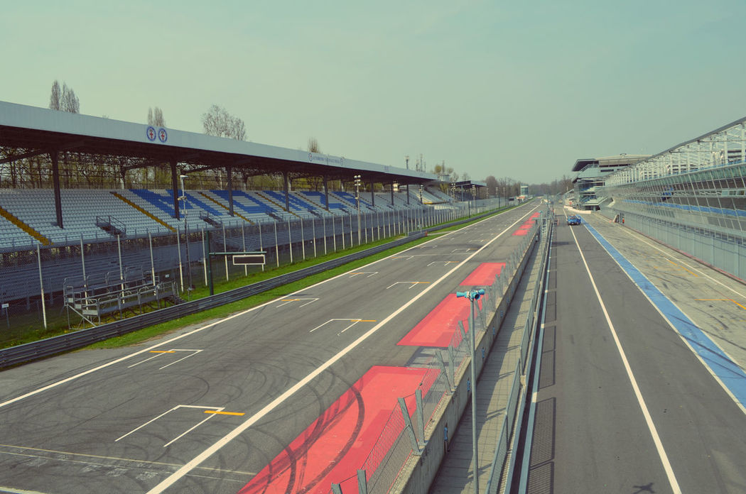 View of the empty race track from the podium Autodromodimonza Empty Monza No People Outdoors Podium Race Track Road Road Marking Vanishing Point