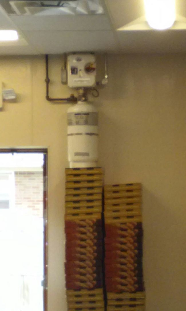 Found this robot holding down boxes at marcos pizza Check This Out