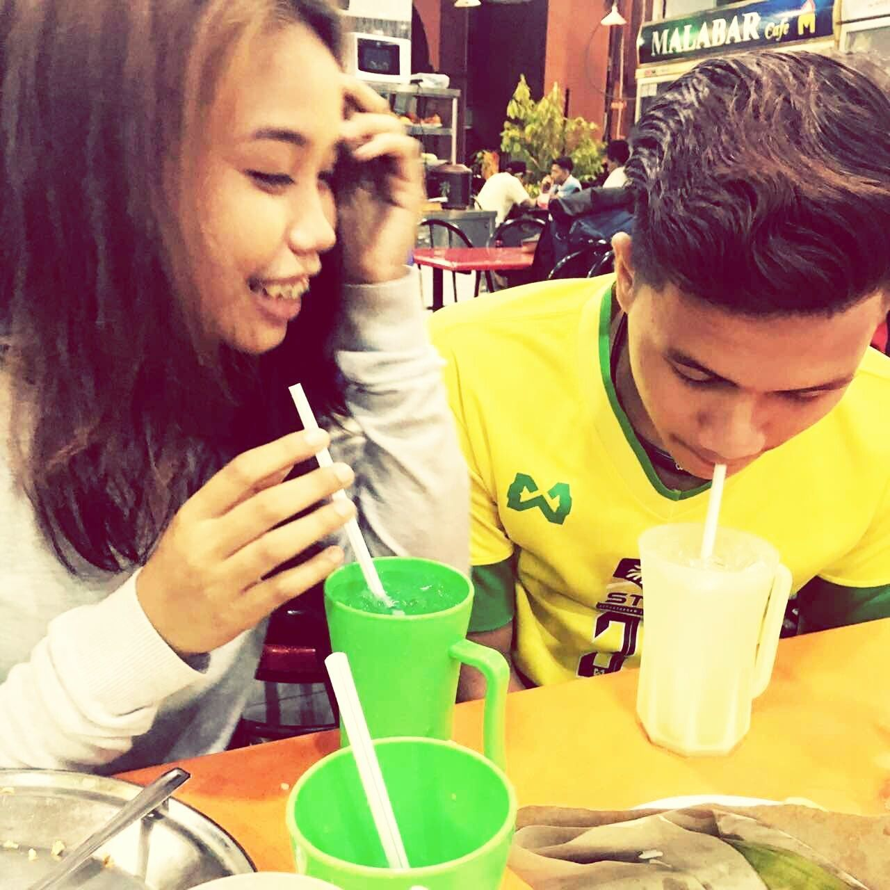 two people, drinking straw, togetherness, holding, drink, real people, childhood, men, indoors, day, adult, people