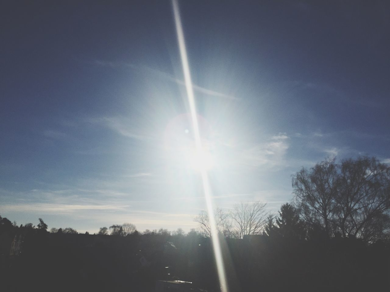 sunbeam, sun, sunlight, nature, beauty in nature, scenics, tranquility, sky, no people, tree, tranquil scene, outdoors, silhouette, day, vapor trail