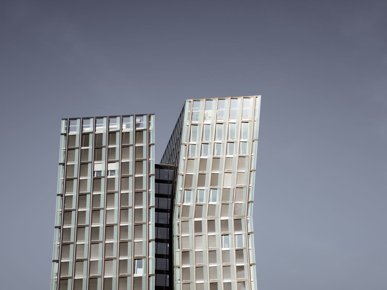 low angle view of skyscraper against clear sky Architecture Building Exterior Built Structure City City Clear Sky Day Gray Background Hamburg Low Angle View Muted Colors No People Outdoors Philipp Dase Sky Skyscraper Summer