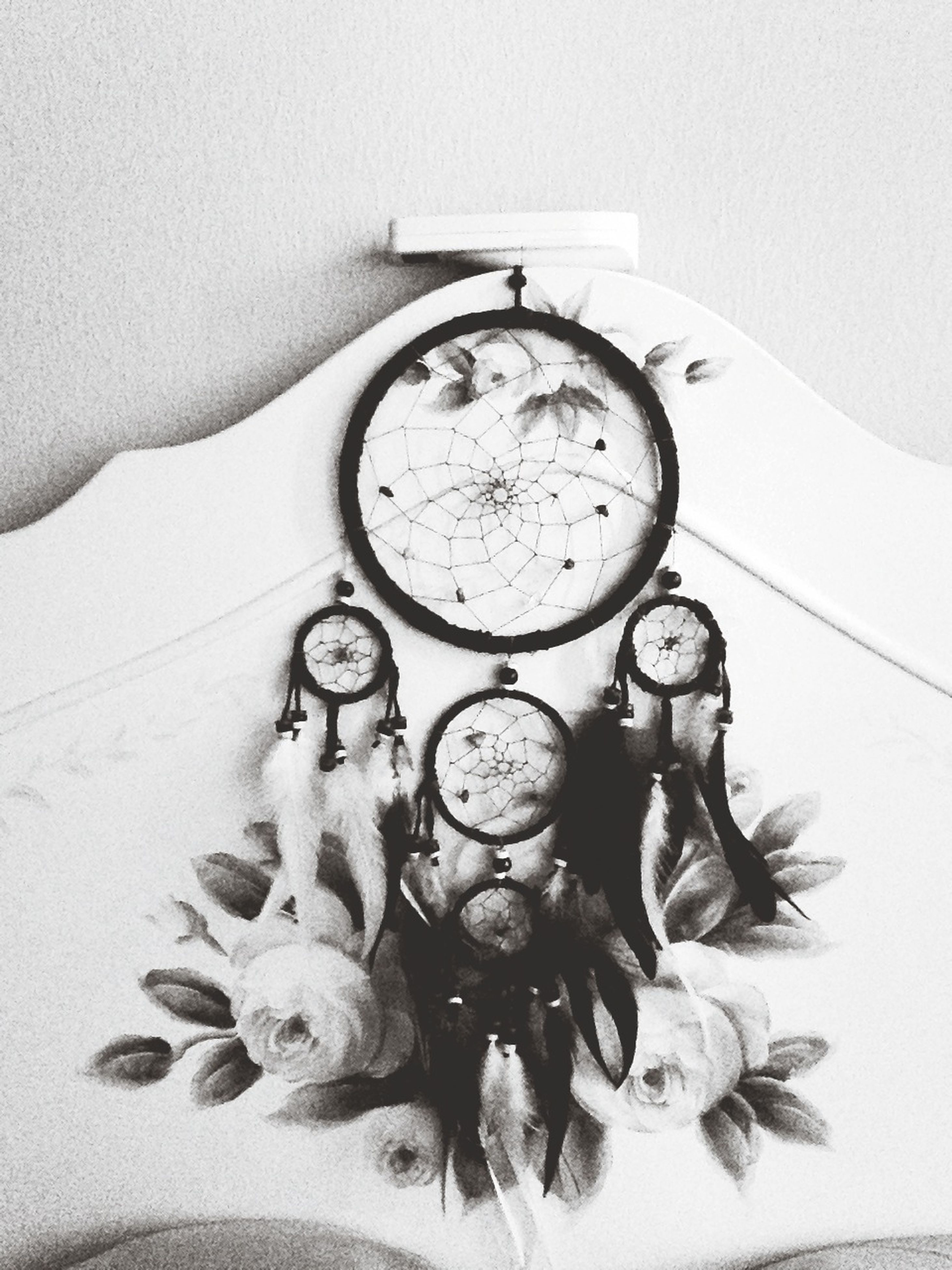 indoors, still life, high angle view, wall - building feature, table, clock, old-fashioned, human representation, close-up, technology, time, retro styled, art and craft, creativity, antique, no people, art, home interior, number, hanging