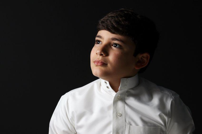Boy Studio Shot Black Background Portrait Childhood People Side Lighting Dramatic Blonde Looking Softbox