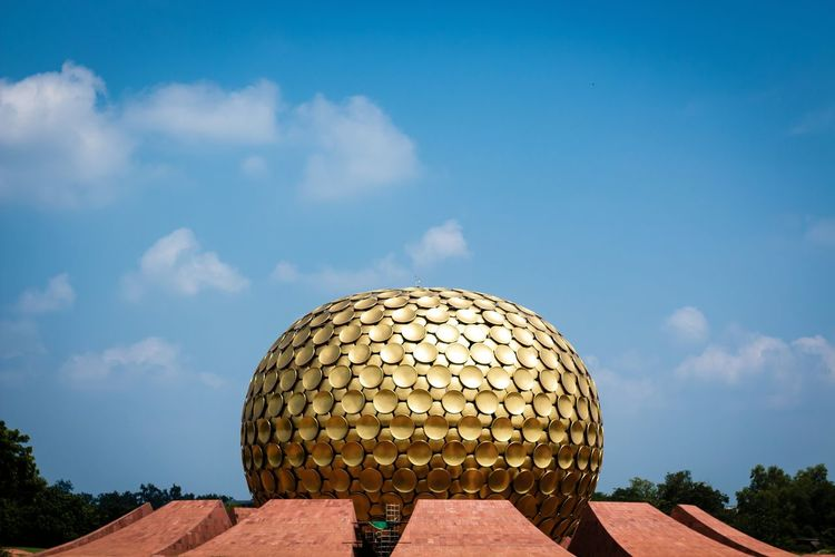 The golden Globe (auroville matrimandir- mother's shrine) this Gold plated Globe has many hidden mysterious facts both on technical and spiritual aspects ... Dome Built Structure Architecture Building Exterior Geometric Shape Sphere Sky Travel Destinations Blue Round Architectural Feature Tourism Outdoors Famous Place High Section Spire  Cloud - Sky Day Circle Pondicherry Tamilnadu Tadaa Community Auroville Landscape Shrine