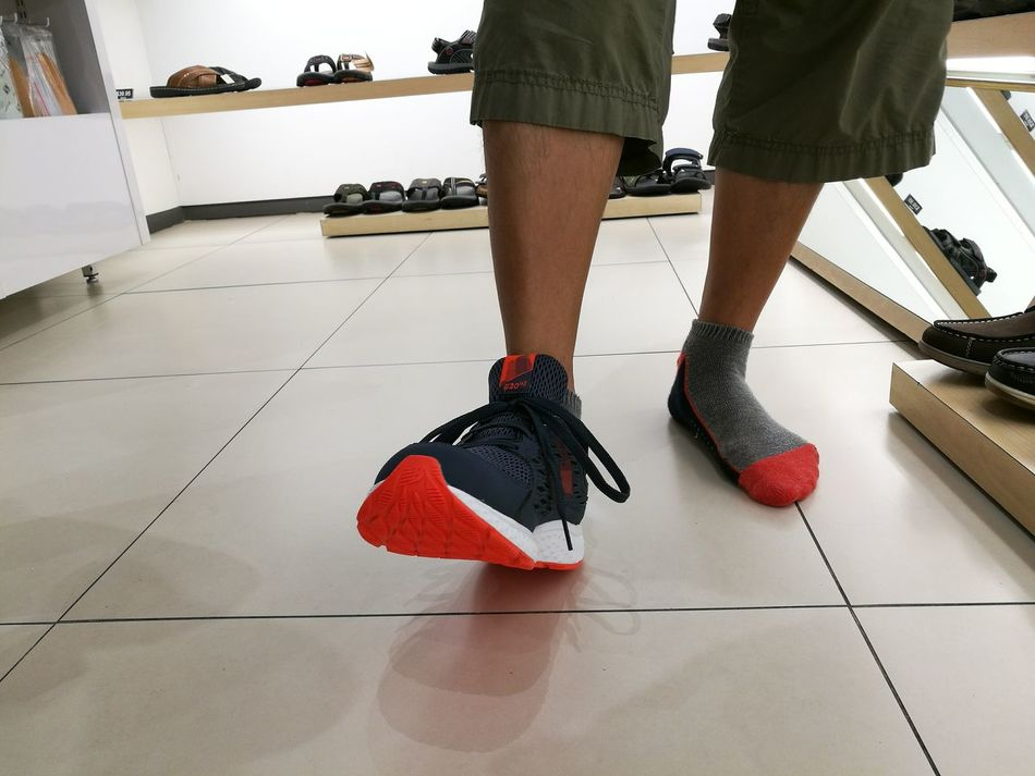 Low Section Adults Only Human Body Part Shoe People Human Leg Human Foot Sports Shoes Sneakershop Sneakers Feet On The Ground Shoe Shopping Shopping Time Shoe Shop Real People One Person Feet Fashion Only Men Men Mirror Lifestyles Standing Shoes Colored Shoes Break The Mold Out Of The Box