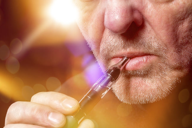 close up portrait of a man smoking an e-cigarette Bokeh Cigarette  Close-up E-Cigarette Ecig Ecigs Equipment Health Inhale Lifestyles Lights Male Man Modern Mouth Nicotine Portrait Smoke Smoking Studio Shot Technology Vapes Vapor First Eyeem Photo