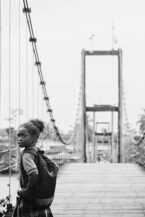 Choco Nuquí Colombia Pacific Coast Bridge Hanging Bridge Girl School Uniform Black And White Streetphotography One Person People Young Adult Outdoors People Watching Travel Portrait School Girl Traveling Uniqueness Women Around The World EyeEm Diversity The Street Photographer - 2017 EyeEm Awards The Portraitist - 2017 EyeEm Awards Connected By Travel Black And White Friday