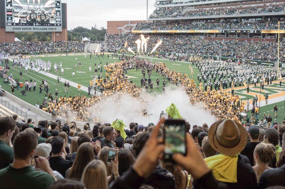 Crowd Large Group Of People Stadium Spectator Sport Football Stadium College Event Cheer Celebration Run Score Touchdown Record Watch Smoke Field Uniforms Clap Architecture Lifestyles