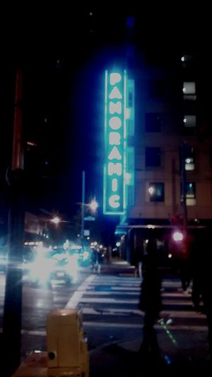 Vintage PANORAMIC argon sign at night in the Mission District. Going Downtown In The Middle Of
