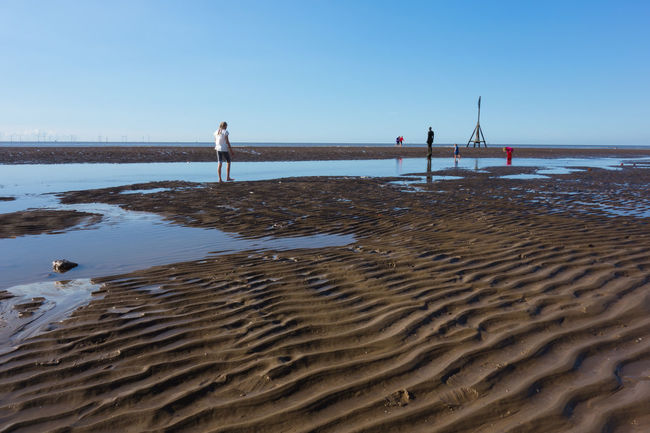 A day on the beach Beach Beauty In Nature Blue Clear Sky Coastal Feature Creativity Crosby Beach Day Nature Outdoors Pier Sand Scenics Sea Shore Tranquil Scene Tranquility Water Wave Pattern