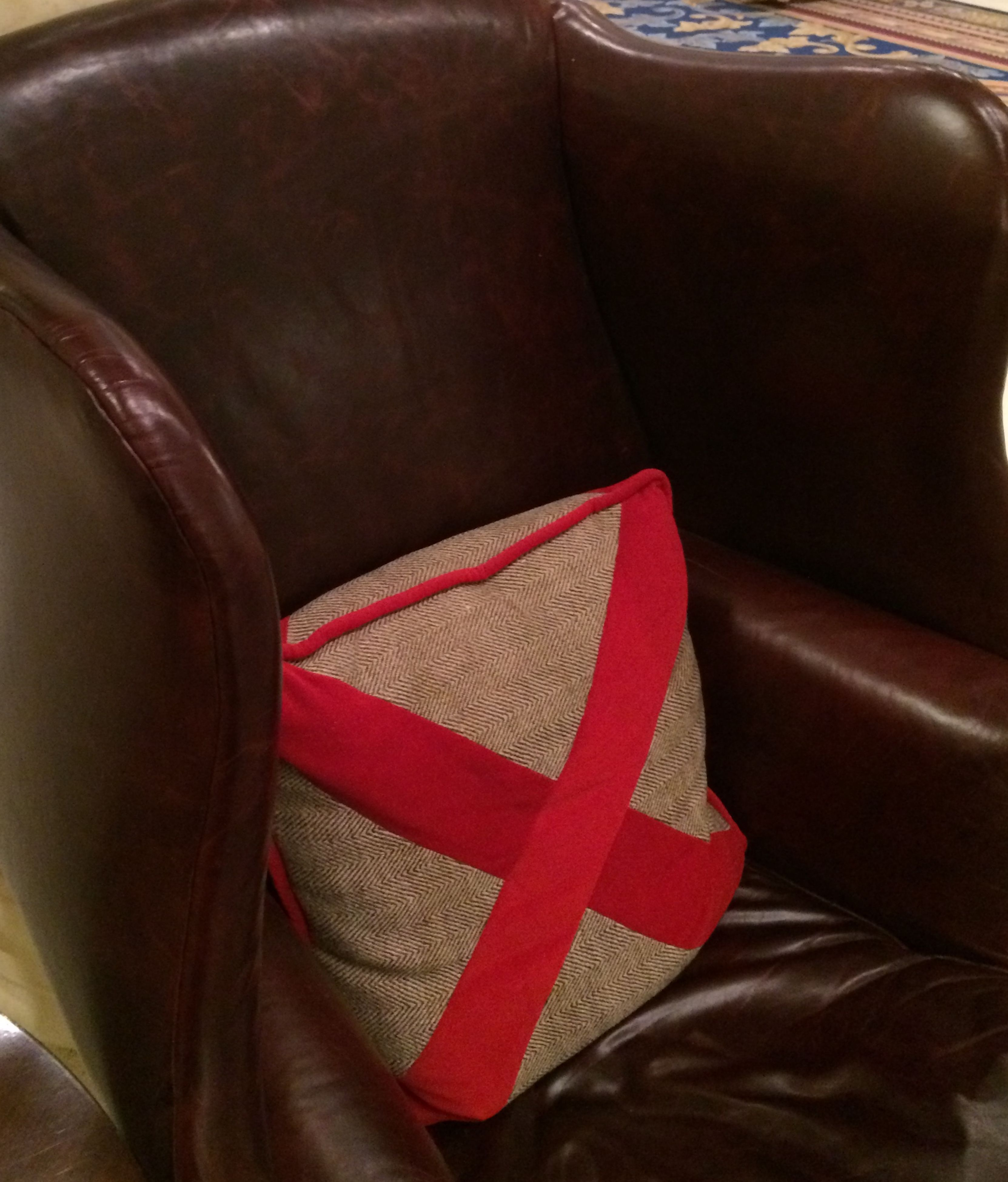 indoors, red, close-up, still life, textile, absence, chair, table, fabric, no people, high angle view, seat, part of, empty, furniture, fashion, book, clothing, detail, shoe