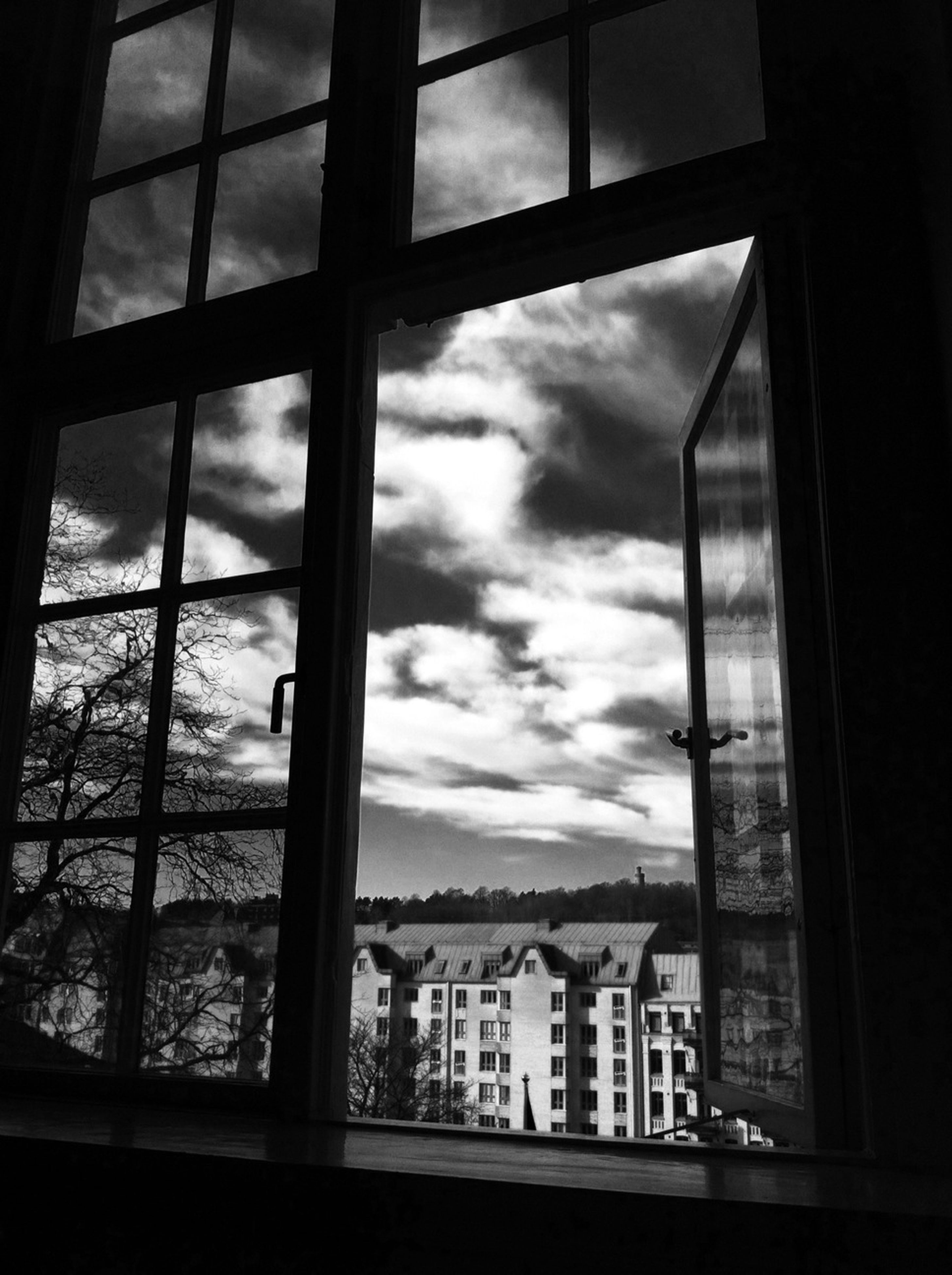 window, architecture, indoors, built structure, sky, cloud - sky, glass - material, transparent, building exterior, cloudy, cloud, day, weather, building, overcast, water, city, reflection, no people, looking through window