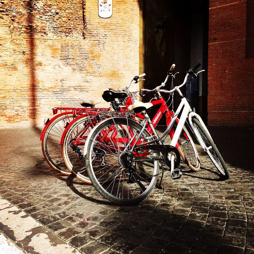 Bike ride in Rome ❤️ Bicycle Architecture Transportation Stationary Built Structure Mode Of Transport Red Building Exterior Land Vehicle No People Outdoors Day Cycling Red Bikes City Rome Italy EyeEm LOST IN London