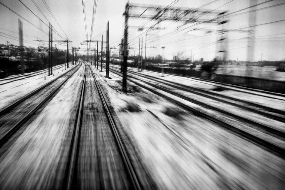 Day Electricity Pylon Long Exposure Motion Motion Blur Nature No People Outdoors Public Transportation Rail Transportation Railroad Track Railway Sky Snow Speed Transportation Tree