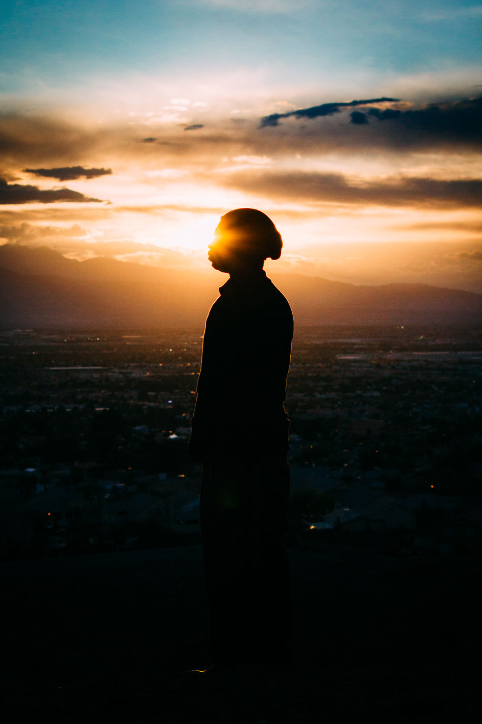 Adult Cityscape Cloud - Sky Day Evening Full Length Man Nature One Person Outdoors People Rear View Silhouette Sky Flowersshng Sunset Vertical Tranquility Tranquil Scene Single Magic Hour Dark Light