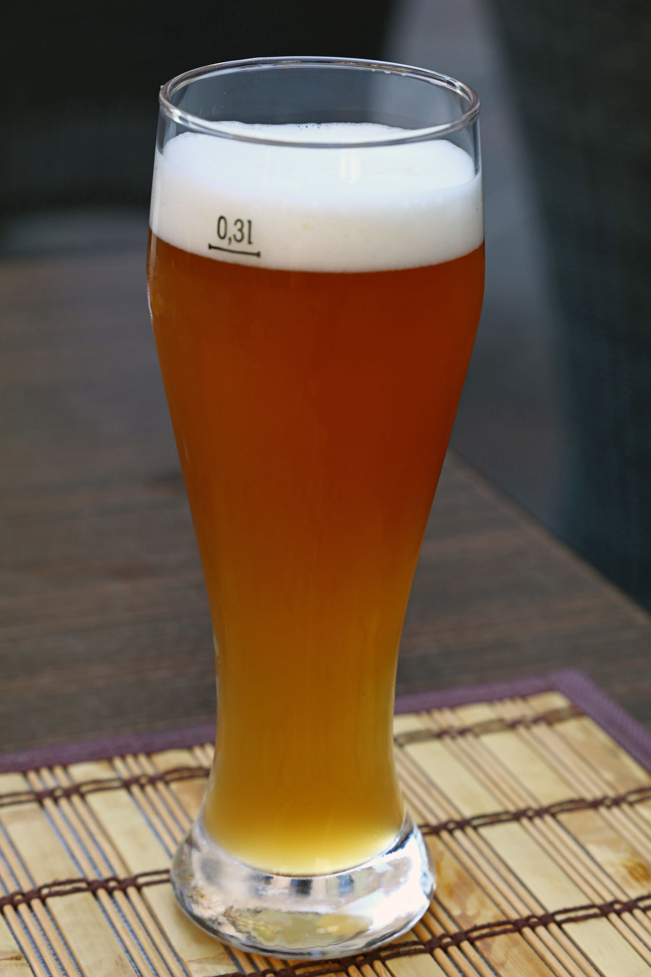A glass of unfiltered wheat (weizen) beer on wooden table Ale Beer Beverage BIG Brewery Close-up Culture Draught Drink Europe Freshness Frothy Drink Full Glass Personal Perspective Refreshment Serving Size Small Table Time Traditional Unfiltered Weizen Weizenbier Wheat