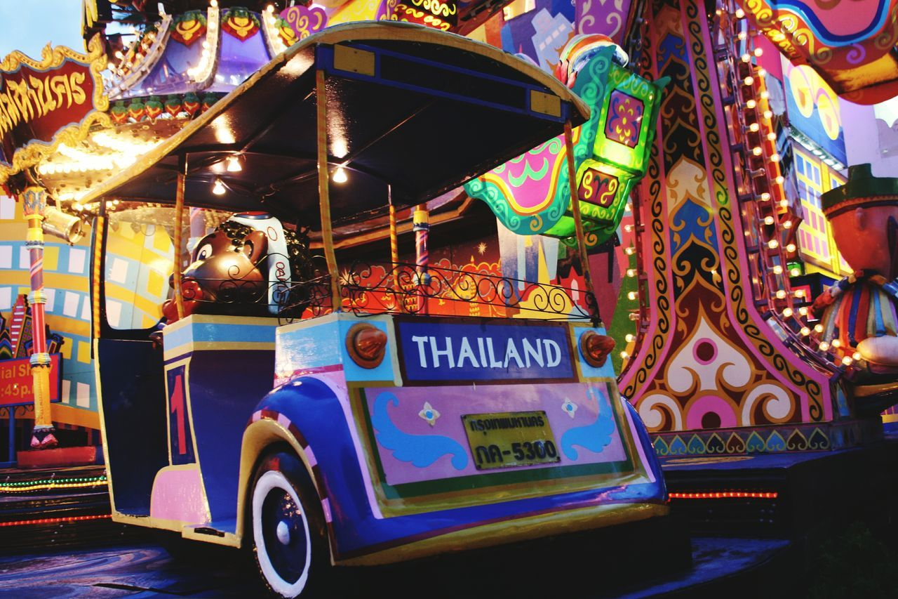 amusement park, amusement park ride, carousel, outdoors, arts culture and entertainment, real people, illuminated, day