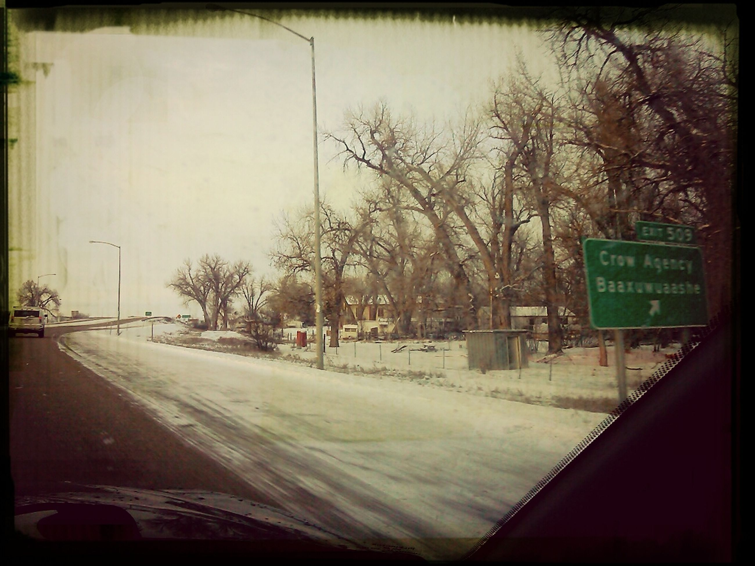 transportation, road, text, transfer print, western script, car, tree, street, communication, auto post production filter, mode of transport, land vehicle, the way forward, road marking, road sign, bare tree, winter, snow, cold temperature, day