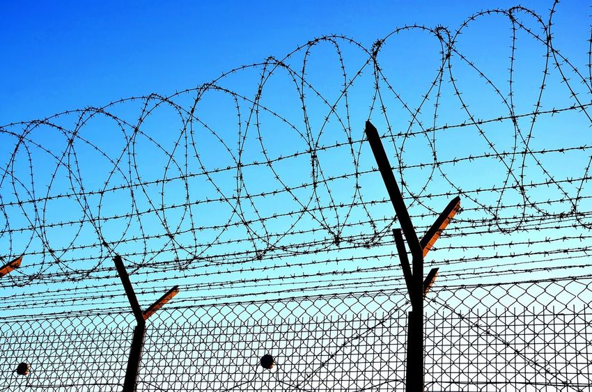 Damaged Razor Wire No People Outdoors Close-up Sky Bared Wire Security Fence Isolation Emigrant Hill Emigrating Prision Security Barbed Wire Sunset Barbedwirefence Emigration Concept Wire Fence Barbed Wire Silhouette Danger Zone Razor Wire Fence Razorwire Protection