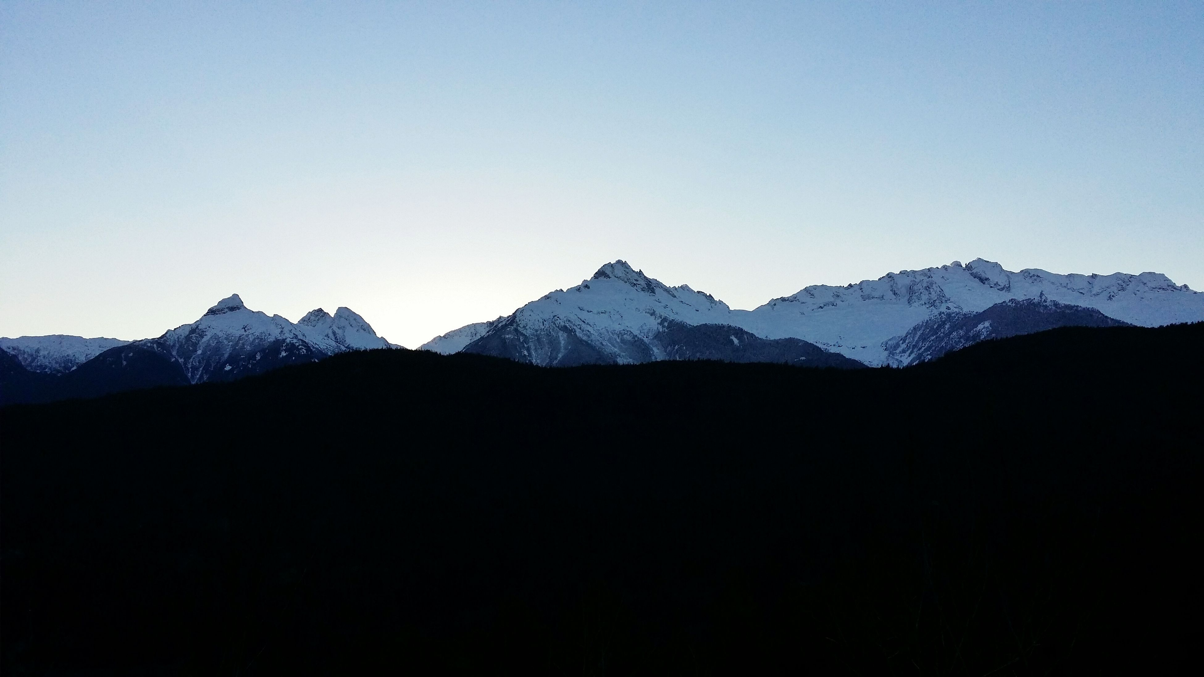 mountain, clear sky, copy space, mountain range, tranquil scene, scenics, tranquility, beauty in nature, snow, winter, nature, cold temperature, landscape, idyllic, majestic, silhouette, blue, snowcapped mountain, non-urban scene, remote