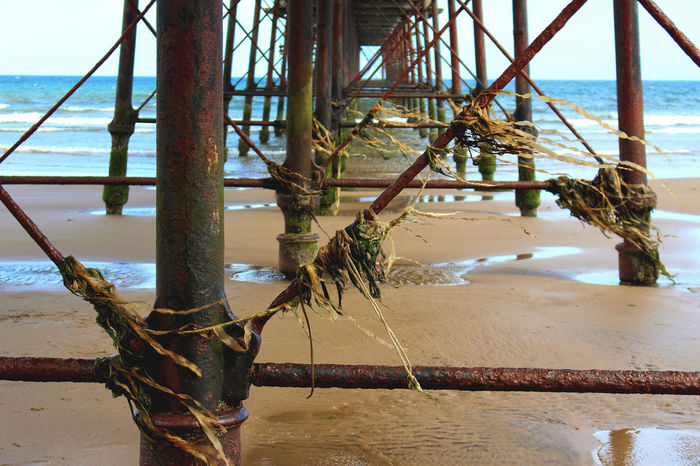 The ageing pier at Saltburn-by-the-Sea on a windy day. Seaweed from the last high tide still tangled round the structure Aging Beach Pier Relaxing Saltburn By The Sea Sand Sea Seaside Seaside_collection Seaweed Tourism Windy