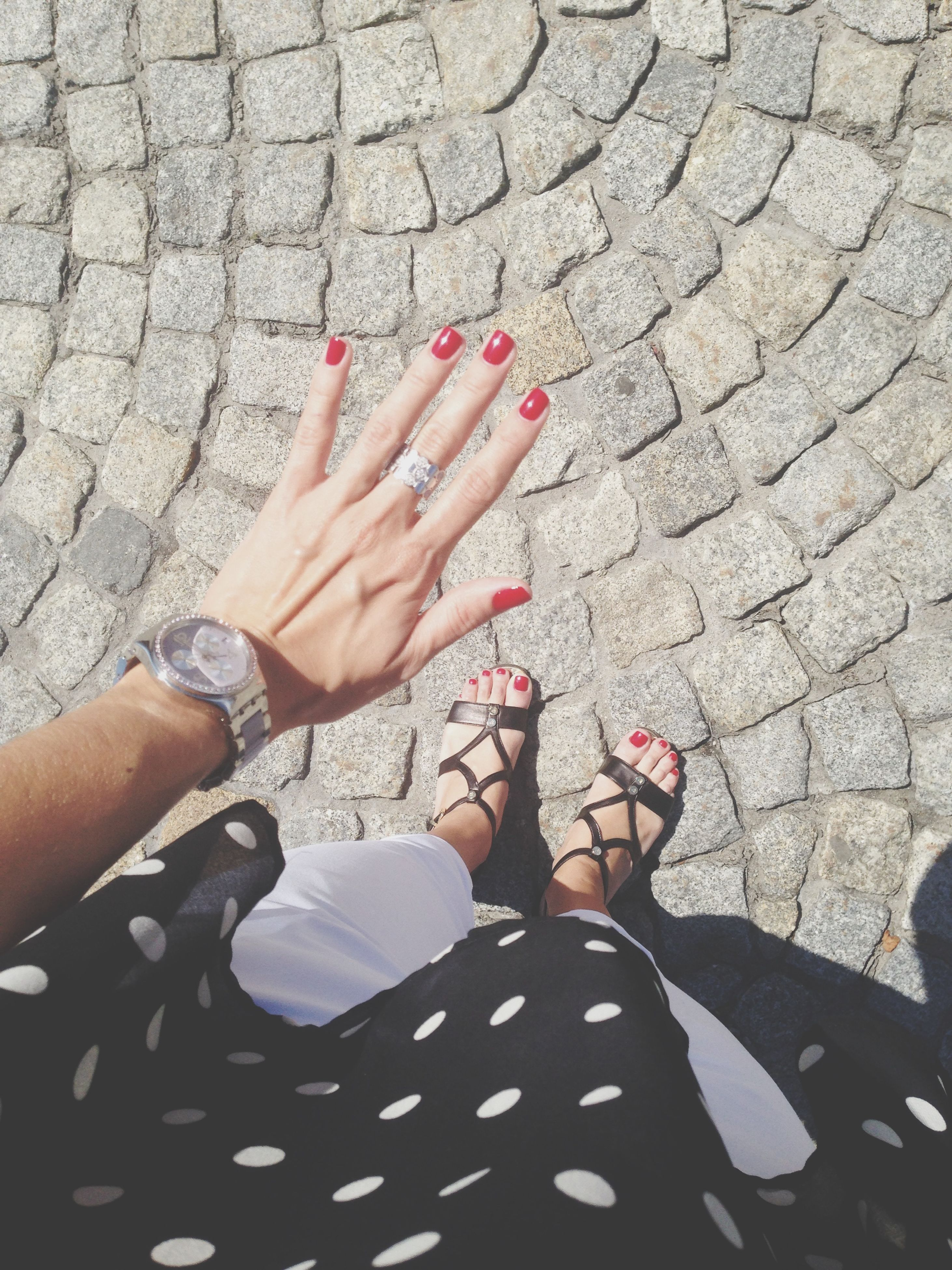 person, low section, lifestyles, personal perspective, part of, leisure activity, high angle view, human foot, human finger, sunlight, cropped, day, standing, outdoors, holding
