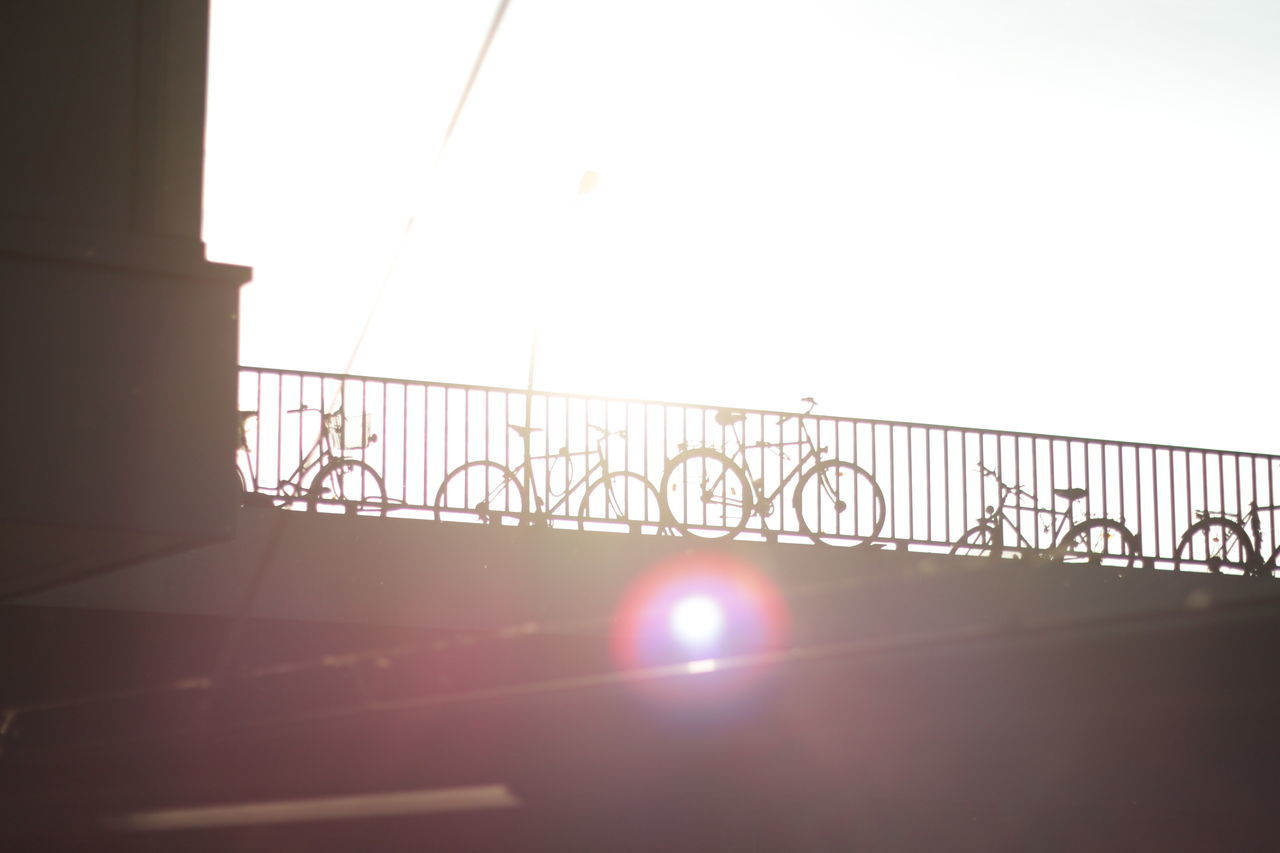 Bikes on a bridge in the sun Architecture Bike Bikes Bridge Built Structure Clear Sky Cycle Cycles Cycling Day Lens Flare Lensflare Low Angle View No People Outdoors Sky Sun Sunlight Sunlight Urban Urban Cycling
