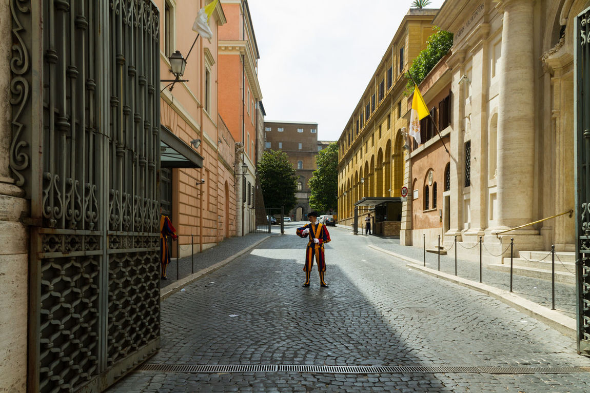 Swiss Guards on Vatican's Street Ancient Door Architecture Army Building Exterior City Street Composition Dress Historic Italy Narrow Outdoors Perspective Rome Soldier Soldiers Street Swiss Guard Uniform Vatican Window