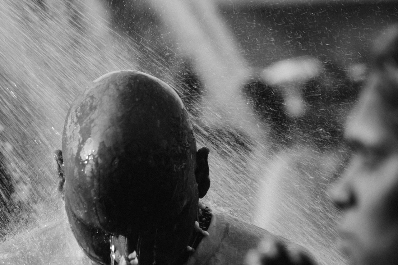A Hindu devotee takes a shower during Thaipusam festival to fulfil their vows and offer thanks to the deities. Batu Caves -Malaysia Black And White Close-up Day Deepavali  Devotees Hindu Culture Hindu God Hindu Temple Hinduism Motion Outdoors Real People Thaipusam Water