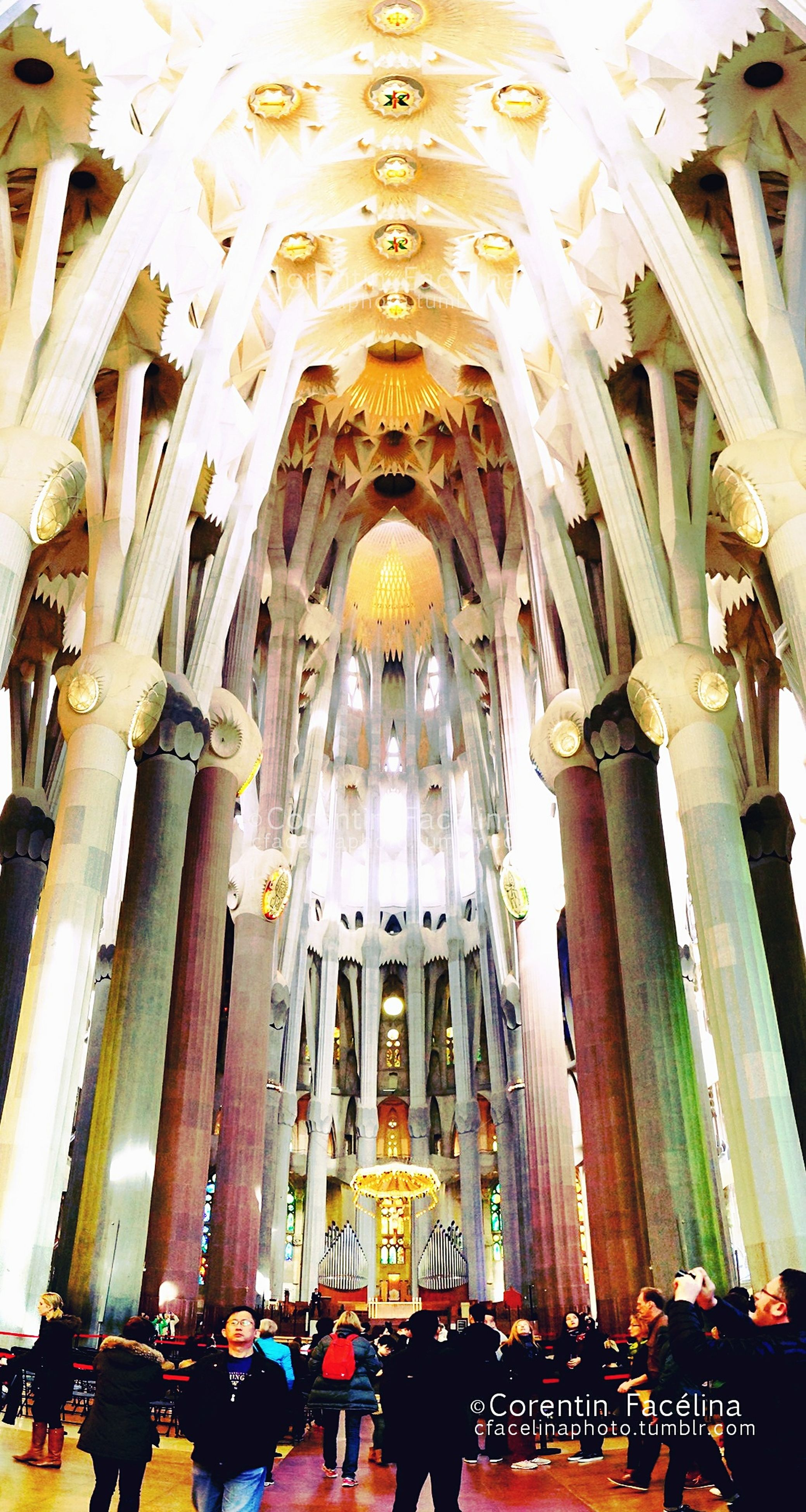 religion, place of worship, spirituality, indoors, church, architecture, low angle view, built structure, cathedral, famous place, travel destinations, tourism, arch, islam, ceiling, illuminated, ornate, chandelier